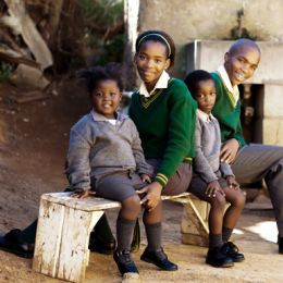 This family of school kids waiting for the bus to their way to school, Africa