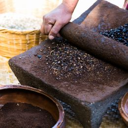 Enchanting Travels Guatemala Tour Traditional Coffee Grinding