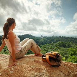 Take in the spectacular views of the ancient Mayan city of Tikal.