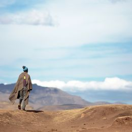 Unidentified Basotho man wearing traditional blanket in the Mountains of Lesotho