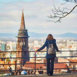 Girl enjoying beautiful panorama of Freiburg im Breisgau in Germany, Europe