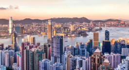 Enchanting Travels Hong Kong Tours Sunset over Victoria Harbor as viewed atop Victoria Peak