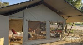 Exterior view of a guest tent at Kwihala Camp Hotel in Ruaha, Tanzania