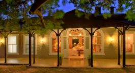 Exterior view at night of Kirkman's Camp in Kruger National Park, South Africa