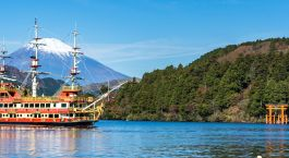 Mountain Fuji and Lake Ashi with Hakone temple and sightseeing boat in autumn