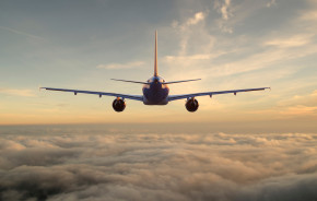 Commercial-passenger-plane-flies-above-the-clouds-towards-the-setting-sun