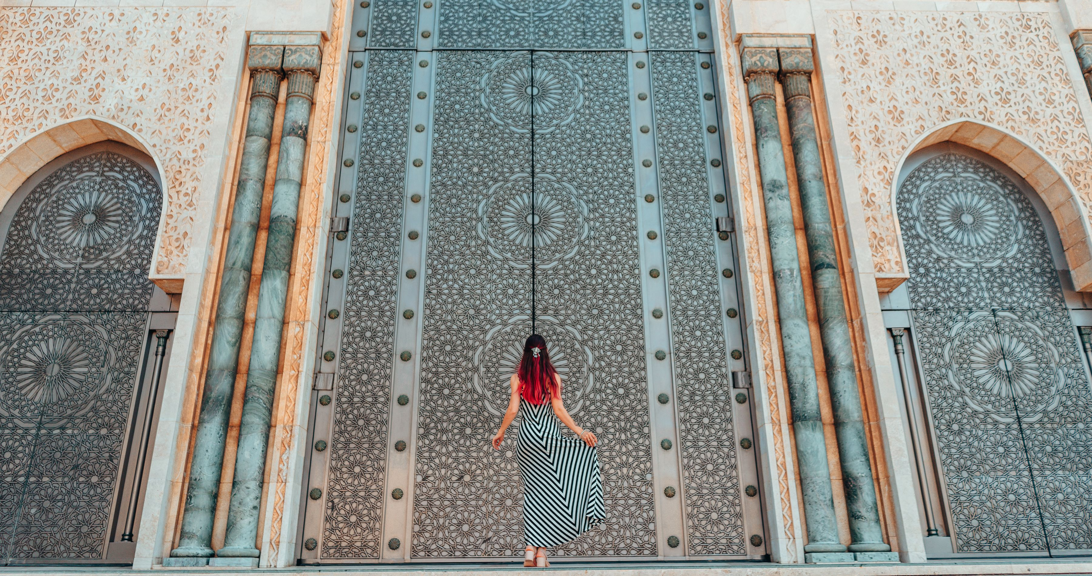 Morocco travel guide - Girls standing in front of greatest mosque Hasan II in Morocco, Africa