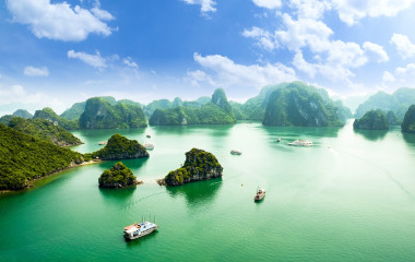 Enchanting Travels - Custom Vietnam Tours-HALONG bay in vietnam. UNESCO World Heritage Site. This view from TiTop island and its most popular view for travel in Halong bay.