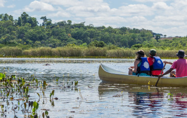 Enchanting Travels Brazil Tours Tourists with a guide in a canoe at Pantanal Marimbus (Marshland Marimbus), Chapada Diamantina, Bahia, Brazil