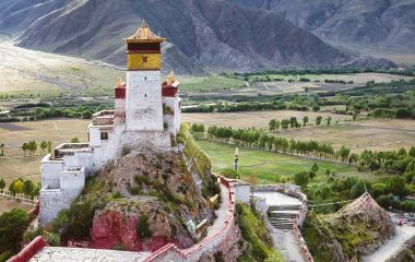 The Yumbulagang Palace over the Tsetang valley in Tibet Tours Enchanting Travels