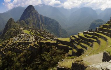 Peru Holidays - Panorama of Machu Picchu, Guard house, agriculture terraces, Wayna Picchu and surrounding mountains in the background - Peru Holidays