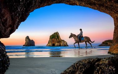 Enchanting Travels New Zealand tours view from the cave of Wharariki Beach