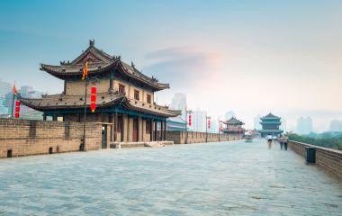 Enchanting Travels China Tours beautiful xian city wall and ancient tower at dusk, China