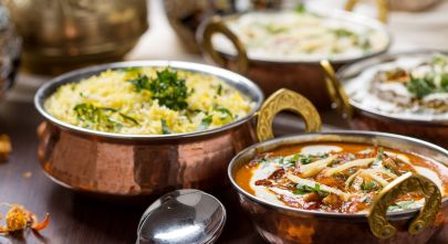 Enchanting Travels Indian Food in brass bowl - Indian Restaurant Guide