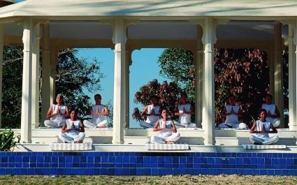 Outdoor group yoga at Ananda Spa in Rishikesh, The Himalayas