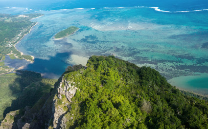 Aerial view to the top of the mountain of Le Morne Brabant and the blue lagoon, Mauritius