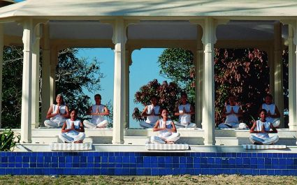 Outdoor group yoga at Ananda Spa in Rishikesh, The Himalayas
