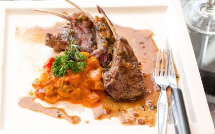 Grilled Race fare medium of New Zealand lamb with Rosemary Sauce International food at restaurant