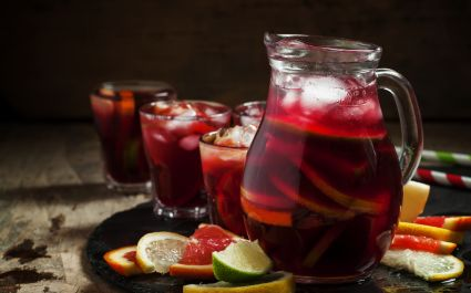 Sangria - This flavorsome punch is served cold and is essentially a mix of red wine, chopped fruit, and brandy. - Spanish cuisine
