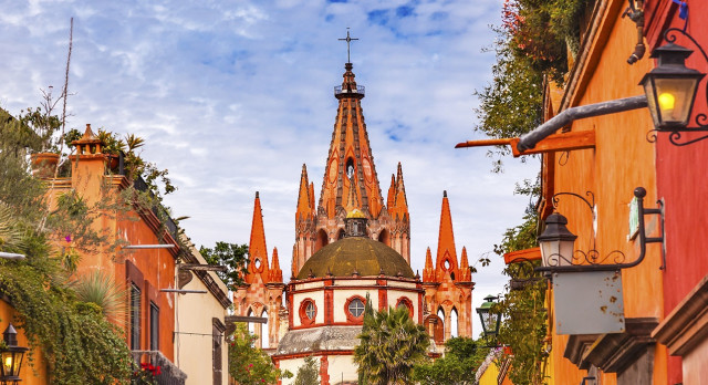 Enchanting Travels Central America Tours Mexico Aldama Street Parroquia Archangel church Dome Steeple