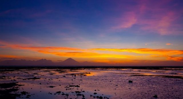 tropical sunset on the beach. lombok island. indonesia