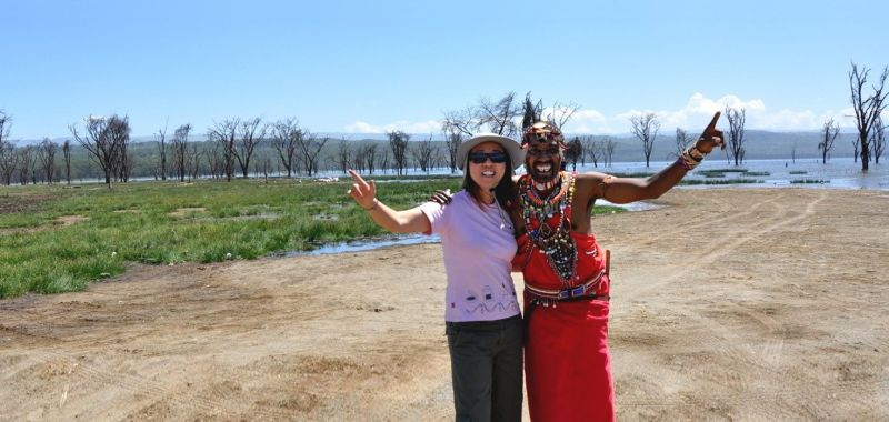 Enchanting Travels Guests in Africa with Maasai people