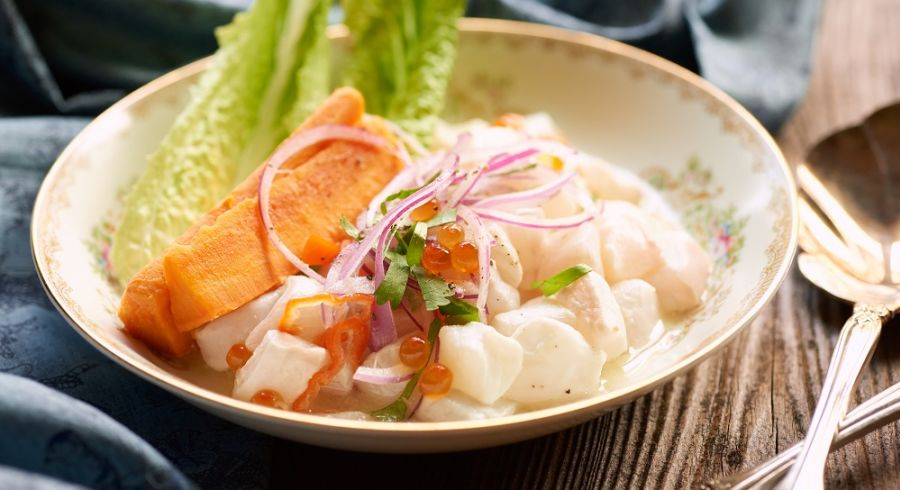 Peruvian ceviche with halibut and roe plated in a classic dish on rustic wood