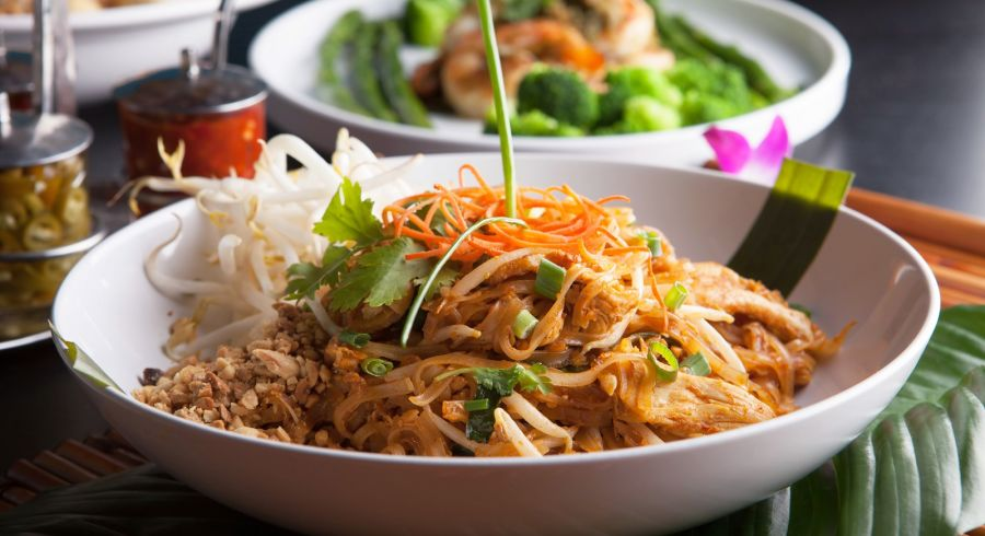 Chicken pad Thai with a variety of other fine Thai food dishes