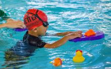 Child enjoying swim lessons at a local Better leisure centre