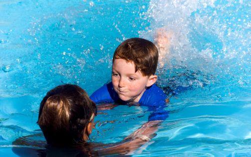 Junior_male_learning_to_swim2.jpg