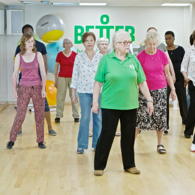 group of older people in social line dancing class