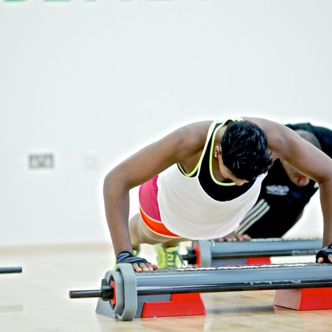 women doing training in a circuit fitness class
