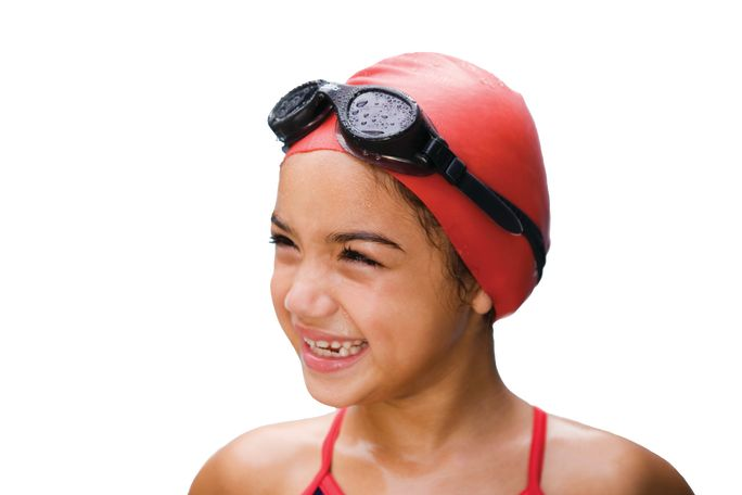 Junior_female_in_swimming_cap_smiling.jpg