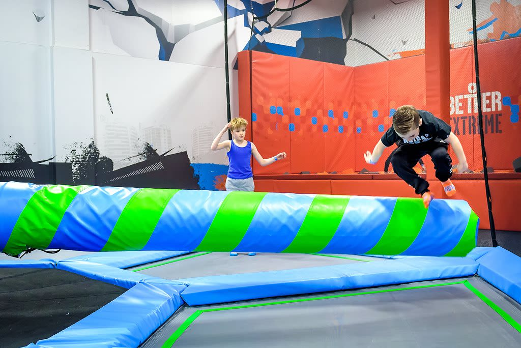 Children enjoying the wipeout area of the trampoline park at Bath Sports and Leisure Centre