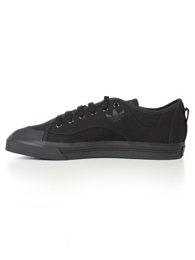 ADIDAS BY RAF SIMONS Sneakers in Black