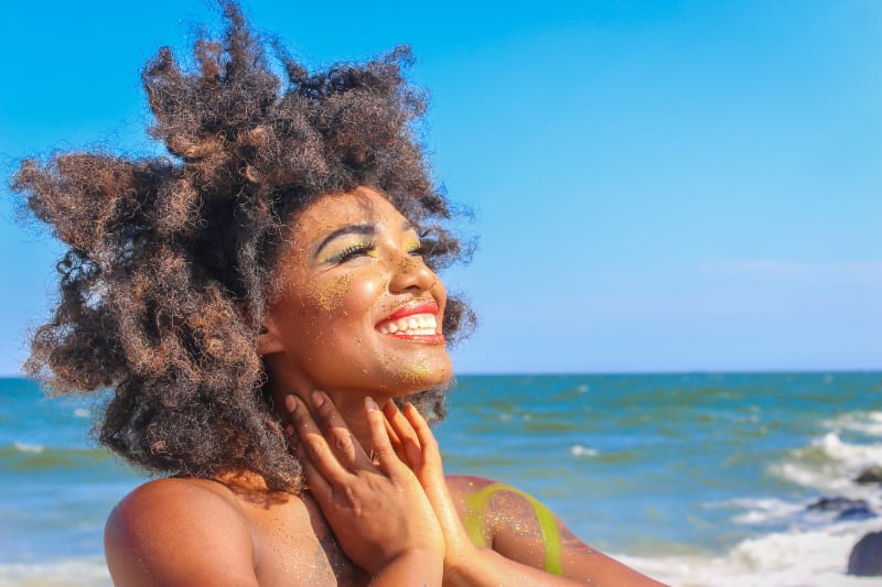 woman on beach smiling with happy energy