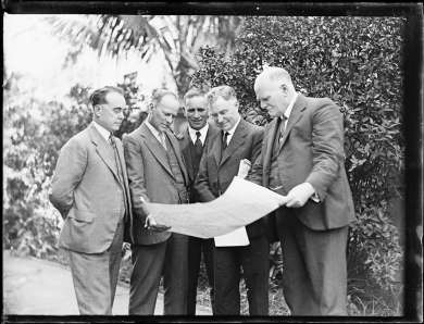 Dr Earle Page examining a plan with four other men, New South Wales, 4 August 1931