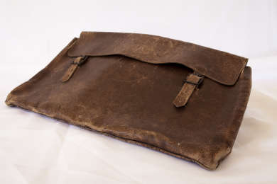 Simple leather satchel used by Joe Lyons throughout his working life from his early years as a teacher in remote Tasmanian schools to his time in State and Federal politics.