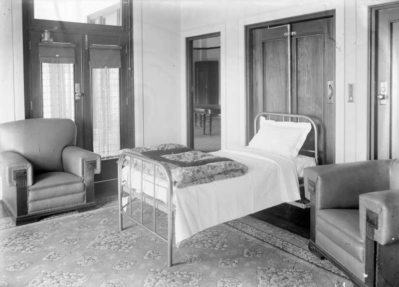 The Prime Minister, Speaker of the House, President of the Senate and Leader of the Government in the Senate each had a fold down bed provided in their rooms at Parliament House in 1927. The bed folded into the cupboard immediately behind it.  NAA: A3560