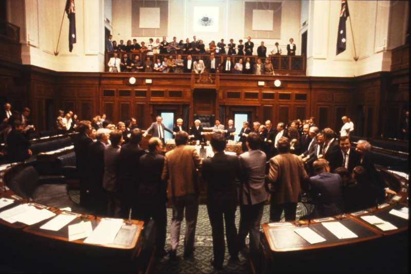 Politicians, staff and press sing Auld Lang Syne to mark the end of the second last sitting in the House of Representatives. Photographer – Robert MacFarlane, Department of the House of Representatives, MoAD Collection.