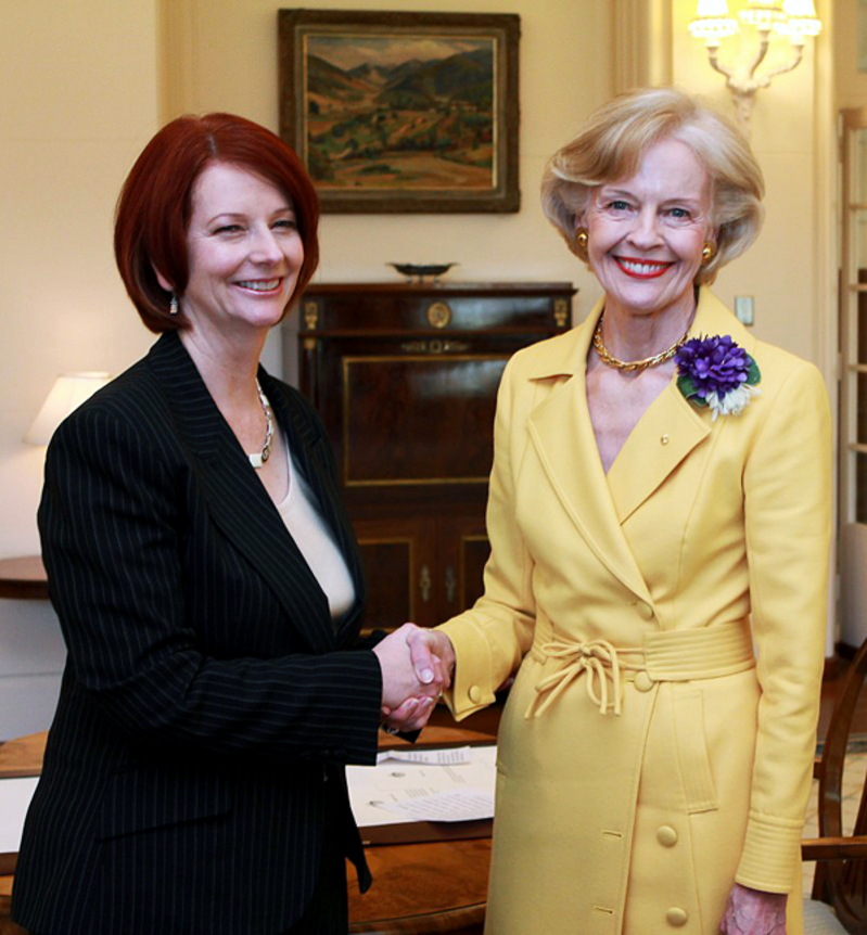 The bright yellow coat and suffrage corsage worn by Dame Quentin Bryce in this photo were donated to the Museum of Australian Democracy in 2010, a recognition of their significance. Fairfax Media.