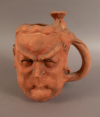 Jug sculpted in the shape of Robert Menzies by John Frith.