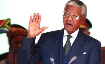 Image of Nelson Mandela being sworn in as President of South Africa. Getty Images.