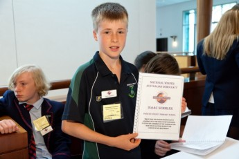 Isaac at the awards ceremony with his prize-winning essay. Photo: Steve Keough