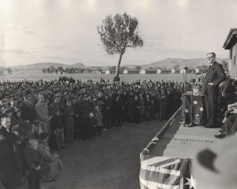 Arthur Calwell addressing new migrants at Bonegilla camp, 1 July 1949. Image: Mary Elizabeth Calwell