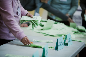 A polling official counts House of Representatives ballot papers at a Melbourne polling place during the 2010 federal election. Image courtesy of the Australian Electoral Commission.