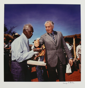 This photo of Gough Whitlam pouring earth through Vincent Lingiari's hand has become an iconic image. It was taken by Mervyn Bishop on 16 August 1975. Museum of Australian Democracy Collection.