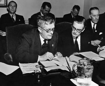 Dr Evatt and Anthony Eden, the UK Foreign Secretary, (seated left and right respectively) examine documents at a meeting in San Francisco, 1945. United Nations photograph.