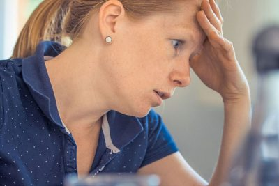 A woman worrying about her bad credit