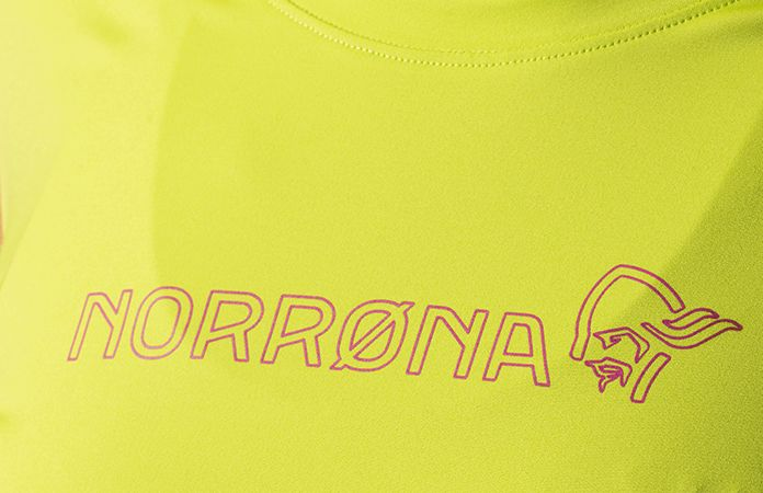 logo detail of the tech long sleeve shirt for women, perfect for your active lifestlye.